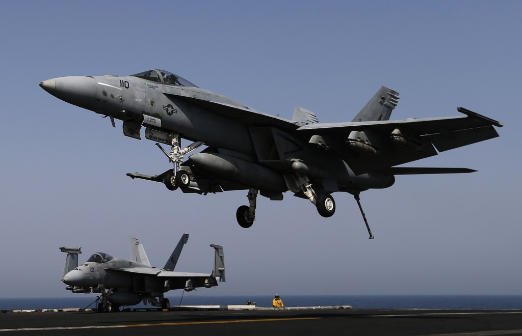 A F/A-18E comes in to land onboard USS George H.W. Bush in the Gulf