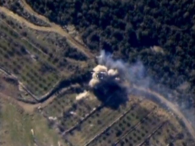Frame grab from footage released by Russia's Defence Ministry shows airstrikes carried out by Russian air force in Syria